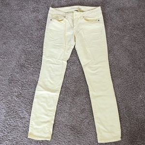 Pale yellow skinny jeans